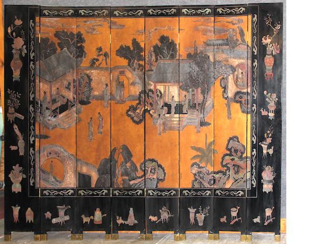 An eight-panel lacquered wood coromandel floor screen
