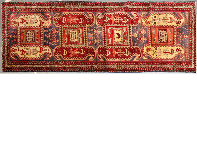 A Northwest Persian runner size approximately 3ft. 8in. x 10ft. 3in.