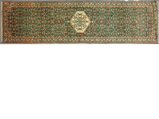 A Northwest Persian runner size approximately 3ft. 4in. x 12ft. 8in.