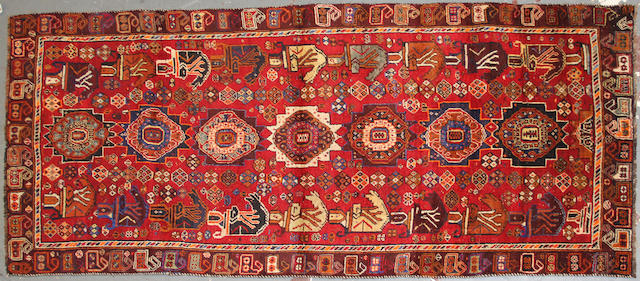 A Southwest Persian runner size approximately 3ft. 10in. x 8ft. 10in.