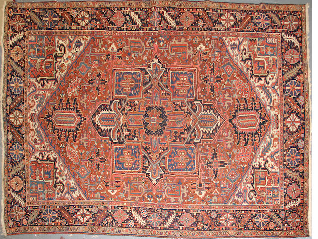 A Heriz carpet size approxiamtely 8in 9in x 12ft