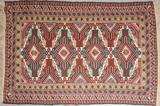 A Soumak rug  size approximately 5ft x 8ft