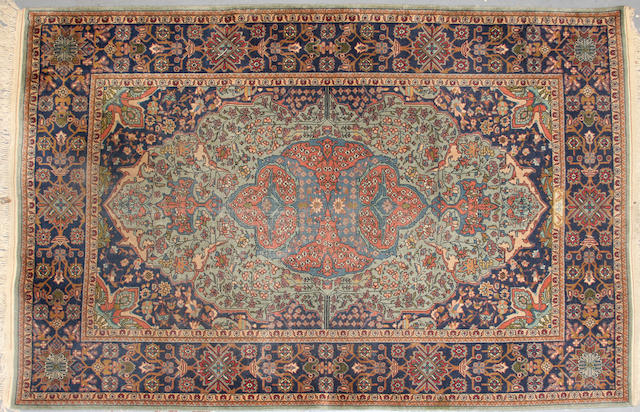 A Turkish rug size approximately 4ft. 11in. x 7ft. 4in.