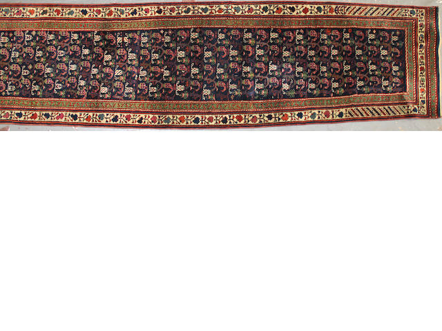 A Kurdish runner size approximately 3ft. 2in. x 19ft. 1in.