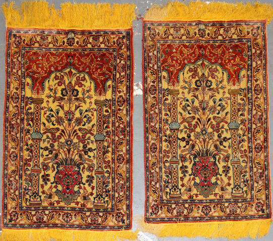 A pair of Kashan souf design rugs size approximately 2ft. 7in. x 4ft.