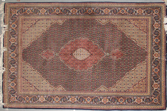 A Tabriz carpet size approximately 6ft. 8in. x 10ft. 3in.