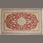 A Nain rug size approximately 5ft. 8in. x 9ft. 6in.