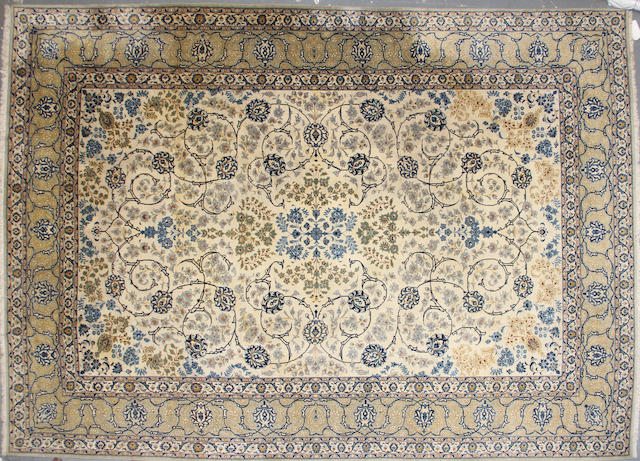 A Kashan carpet  size approximately 9ft. x 12ft. 7in.