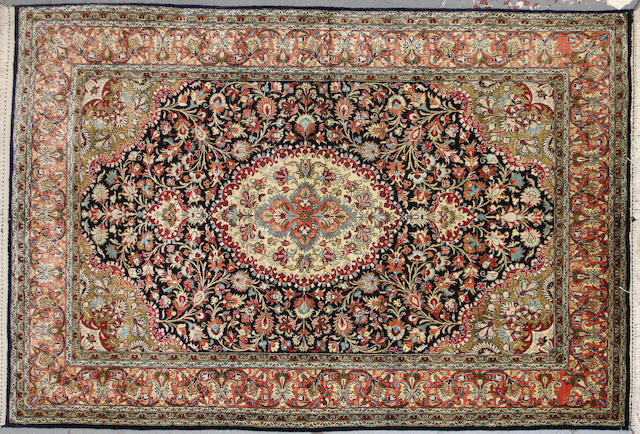 A Qum silk rug  size approximately 3ft. 7in. x 5ft. 3in.