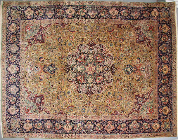 A Tabriz carpet  size approximately 10ft. x 12ft. 5in.