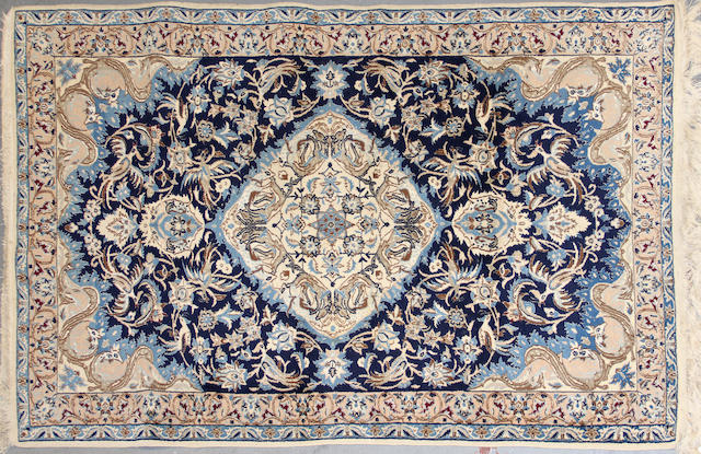 A Nain rug  size approximately 4ft. 1in. x 6ft. 5in.