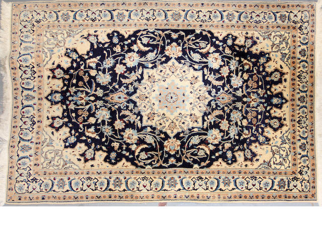 A Nain rug  size approximately 4ft. 3in. x 6ft. 3in.