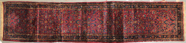 A Sarouk runner size approximately 2ft. 5in. x 11ft. 7in.