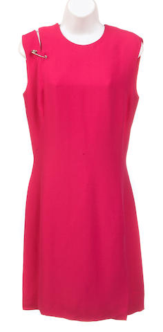 A Gianni Versace fuchsia sleeveless dress with safty pin closure at one shoulder