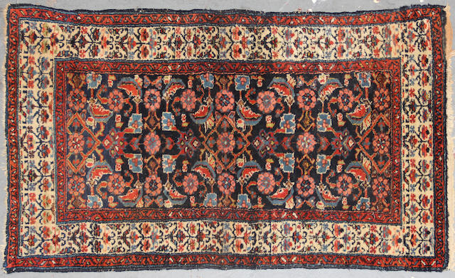 A Hamadan rug  size approximately 2ft. 6in. x 4ft. 1in.