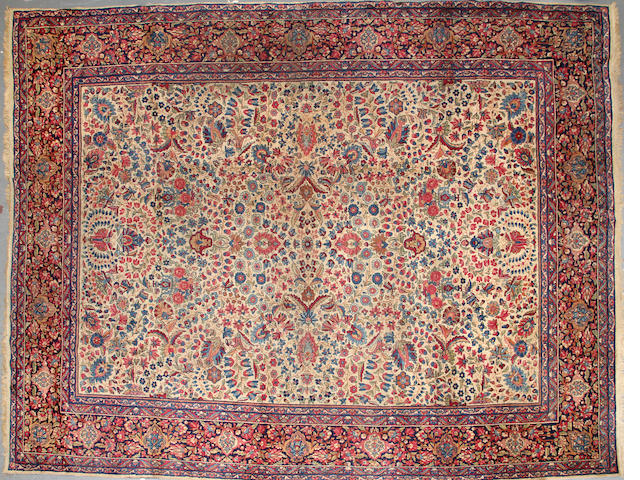 A Kerman carpet  size approximately 10ft. x 12ft.