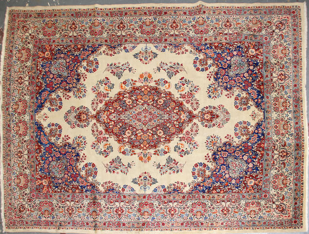 A Kerman carpet size approximately 8ft. 8in. x 11ft. 8in.