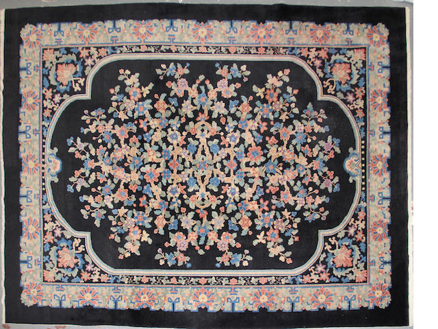 A Chinese carpet  size approximately 9ft. x 11ft. 8in.