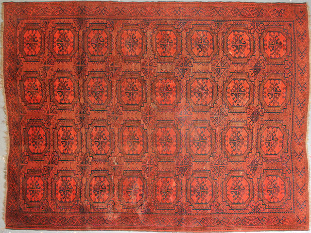An Afghan carpet size approximately 6ft. 11in. x 9ft. 2in.