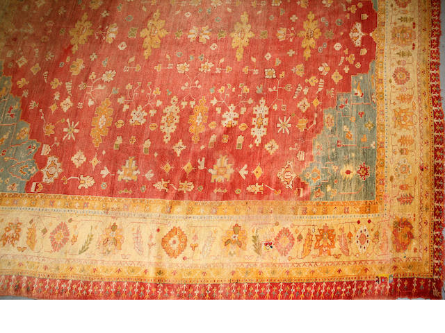 An Oushak carpet size approximately 13ft. 9in. x 15ft. 2in.