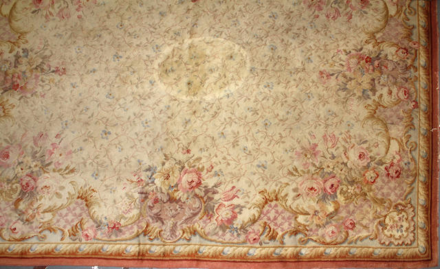 An Austrian Savonnerie carpet  size approximately 10ft. 9in. x 13ft. 8in.