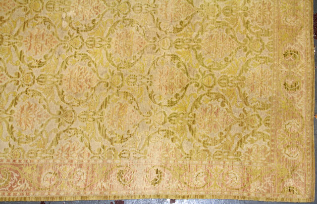 A Portugese carpet  size approximately 11ft. 4in. x 14ft. 4in.