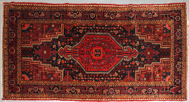 A Northwest Persian rug size approximately 4ft. 8in. x 8ft. 9in.