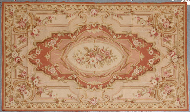 A Pair of Aubusson Design Chinese needlepoints size approximately for each is 2ft. 11in. x 4ft. 10in.