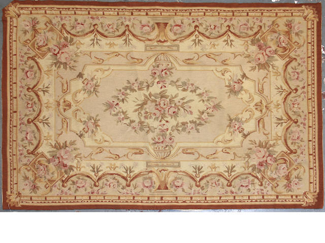 A Pair of Aubusson Design Chinese needlepoints size approximately for each is 3ft. 10in. x 5ft. 11in.
