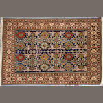 A Northwest Persian rug size approximately 3ft. 4in. x 4ft. 11in.