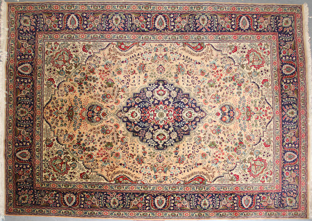 A Tabriz carpet  size approximately 8ft. 1in. x 11ft. 6in.