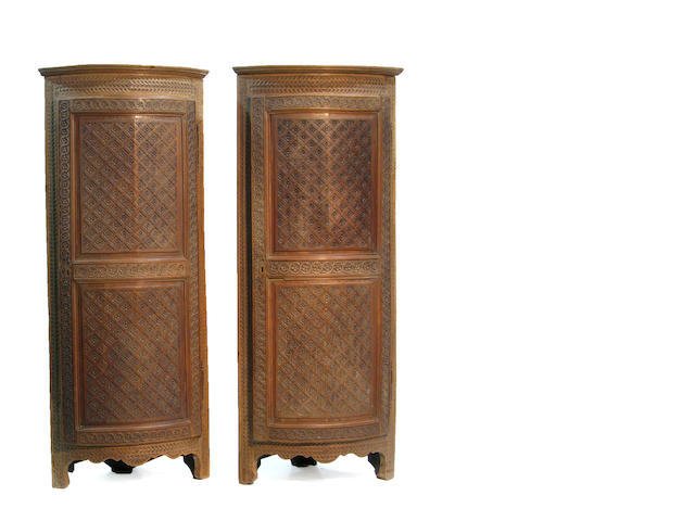 A pair of Continental oak corner cabinets 18th century