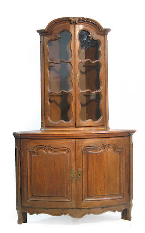 A Louis XV Provincial stained pine corner cabinet
