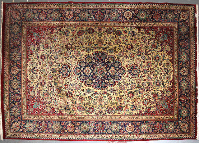 A Tabriz carpet  size approximately 8ft. 2in. x 11ft. 7in.