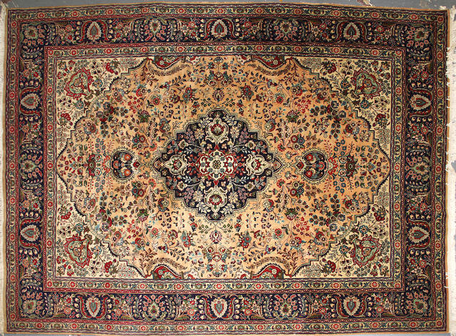 A Tabriz carpet size approximately 8ft. 2in. x 11ft. 3in.