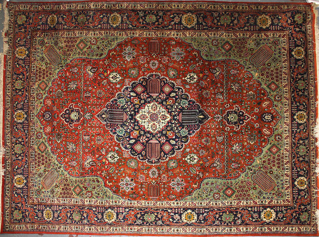 A Tabriz carpet size approximately 9ft. 8in. x 13ft.