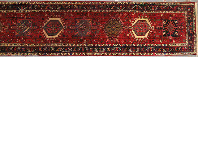 A Karadja runner size approximately 2ft. 10in. x 14ft. 8in.