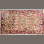 A Kerman rug size approximately 4ft. x 7ft.