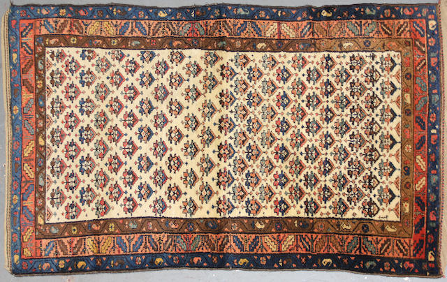A Kurdish rug size approximately 3ft. 10in. x 6ft. 6in.