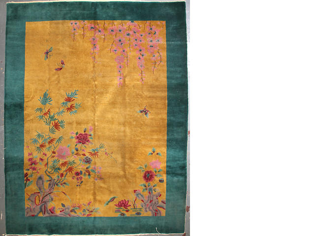 A Chinese Art Deco carpet size approximately 9ft. x 12ft.