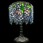 A Tiffany Studios Favrile glass and patinated-bronze Pony Wisteria table lamp circa 1910