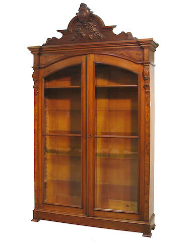 A Renaissance Revival walnut bookcase cabinet fourth quarter 19th century