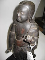 A lacquered wood sculpture of a Buddhist figure 19th century