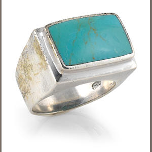 A JIMI HENDRIX OWNED SILVER AND RECTANGULAR TURQUOISE STONE RING