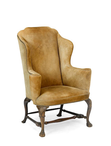 A George III walnut wingchair  third quarter 18th century