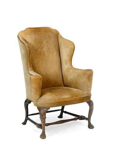 A George III walnut wingchair  third quarter 18th century