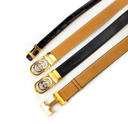A group of four Gucci and Hermes belts