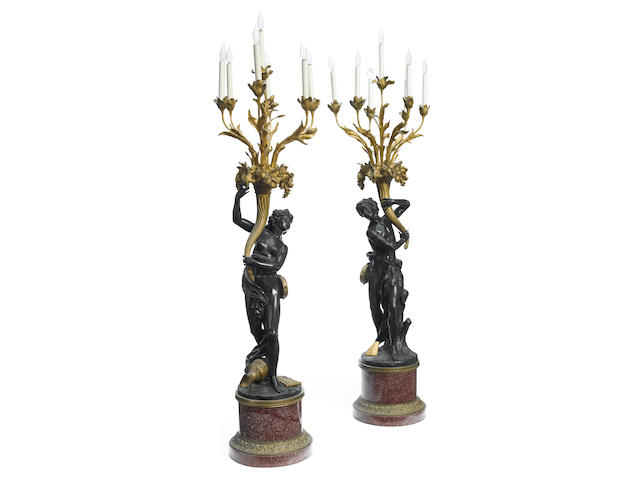 A good and imposing pair of French gilt and patinated bronze and porphyry seven light figural candelabra