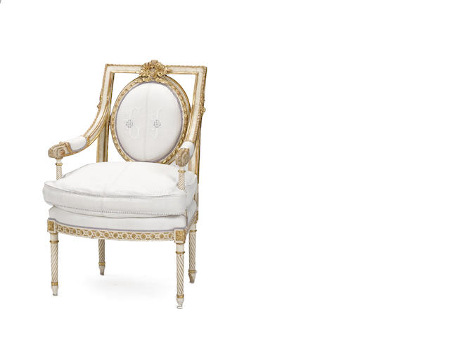 A Continental Neoclassical painted and giltwood armchair