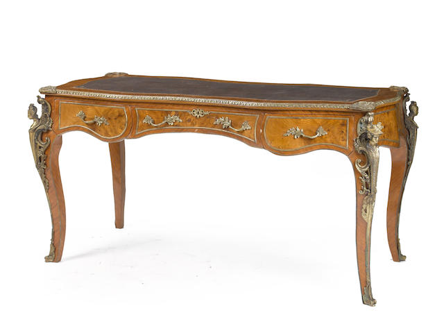 A Louis XV style gilt metal mounted mahogany bureau plat